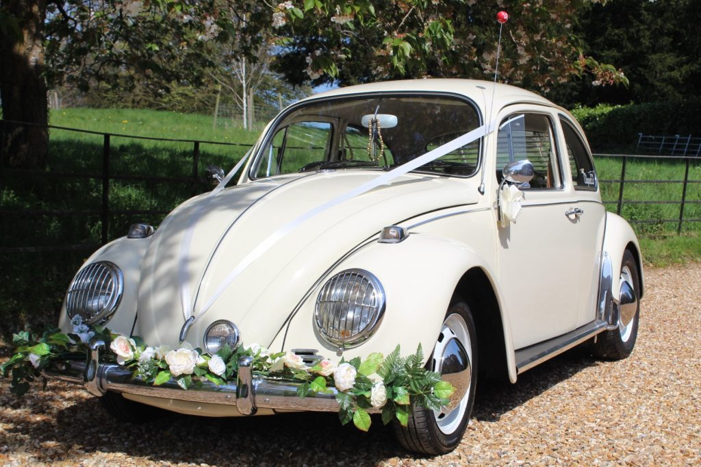 Cream beetle with white ribbons, bows and flowers