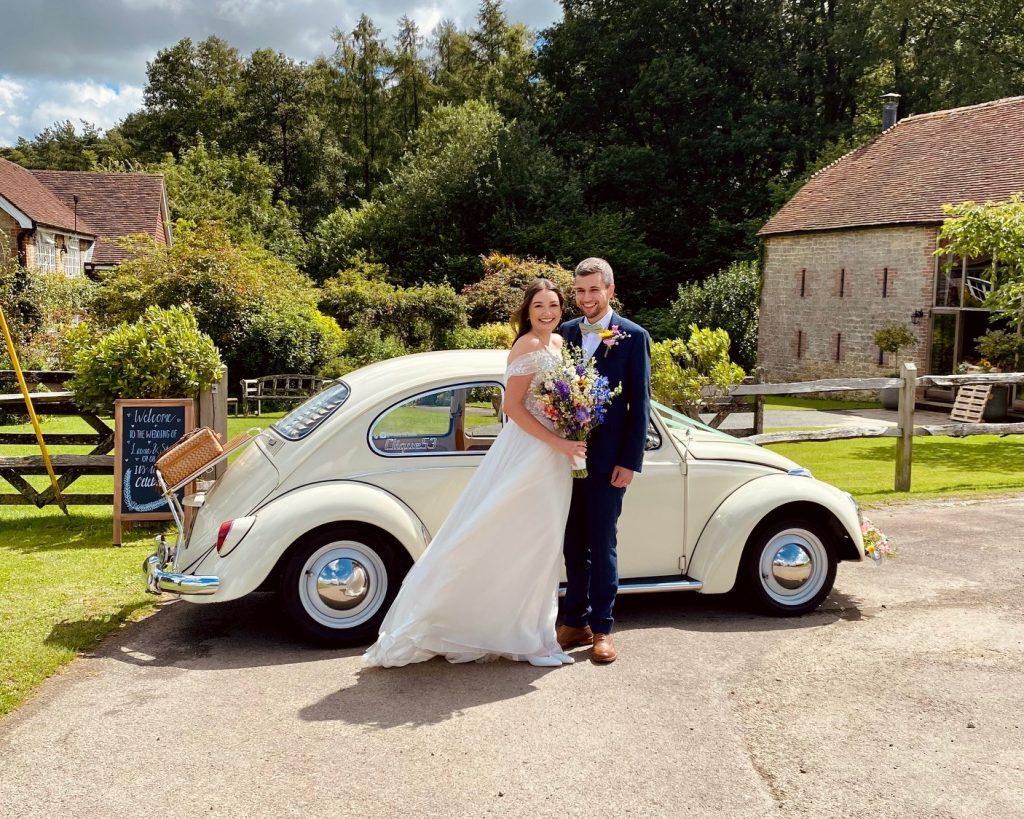 Cream beetle with newlywed couple